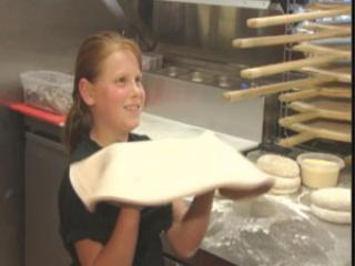 Juliana Zarou works with pizza dough