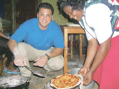 Contributed Waleed Zarou teaches a Kenyan woman to make pizza