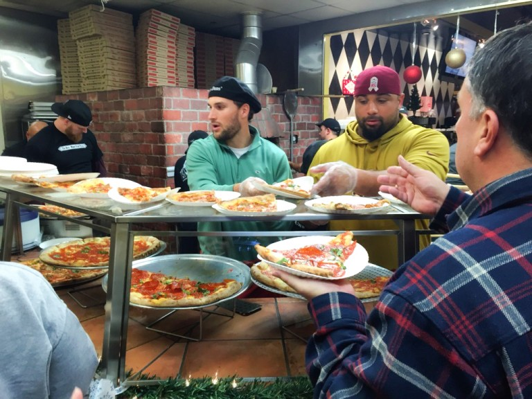 Kirk Cousins and Kedric Golston Serve Pizza